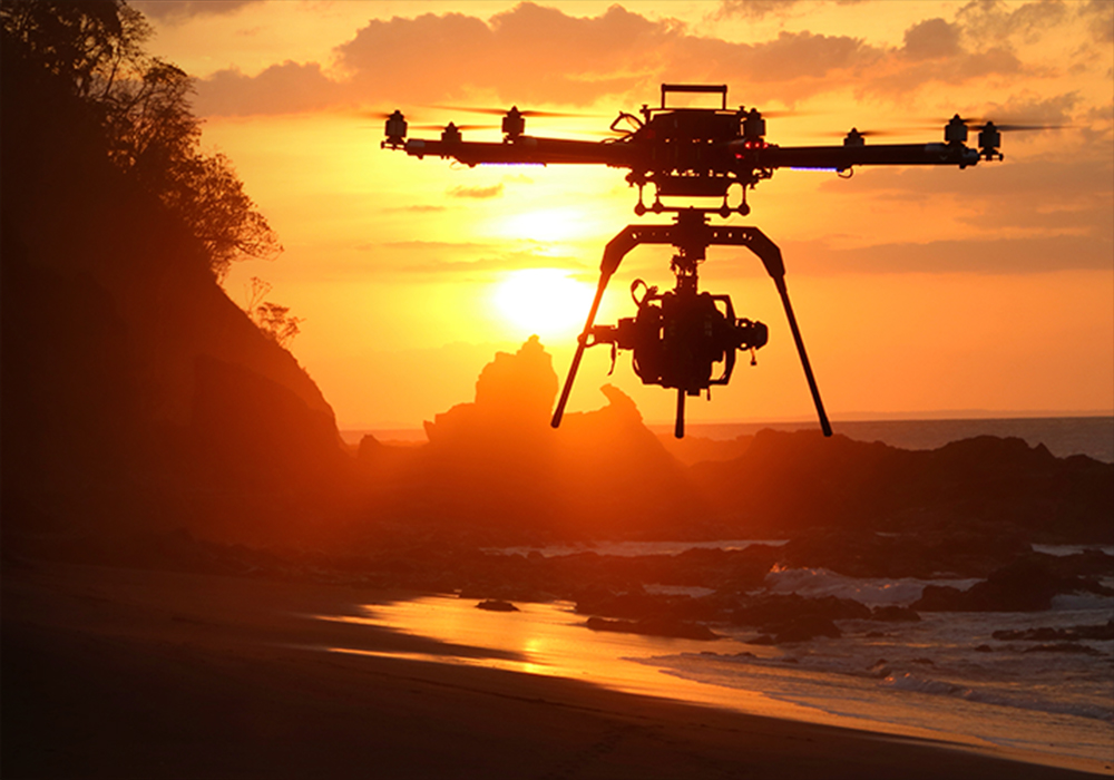 Drone flying dawn beach